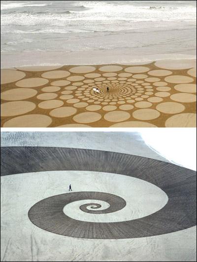 بالصور: لوحات فنية رائعة رسمت على الرمال