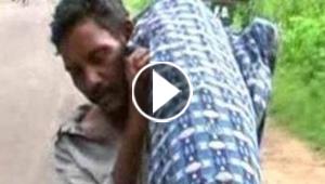 فيديو مؤثر.. هندي يجمل جثة زوجته لمسافة 12 كم لدفنها